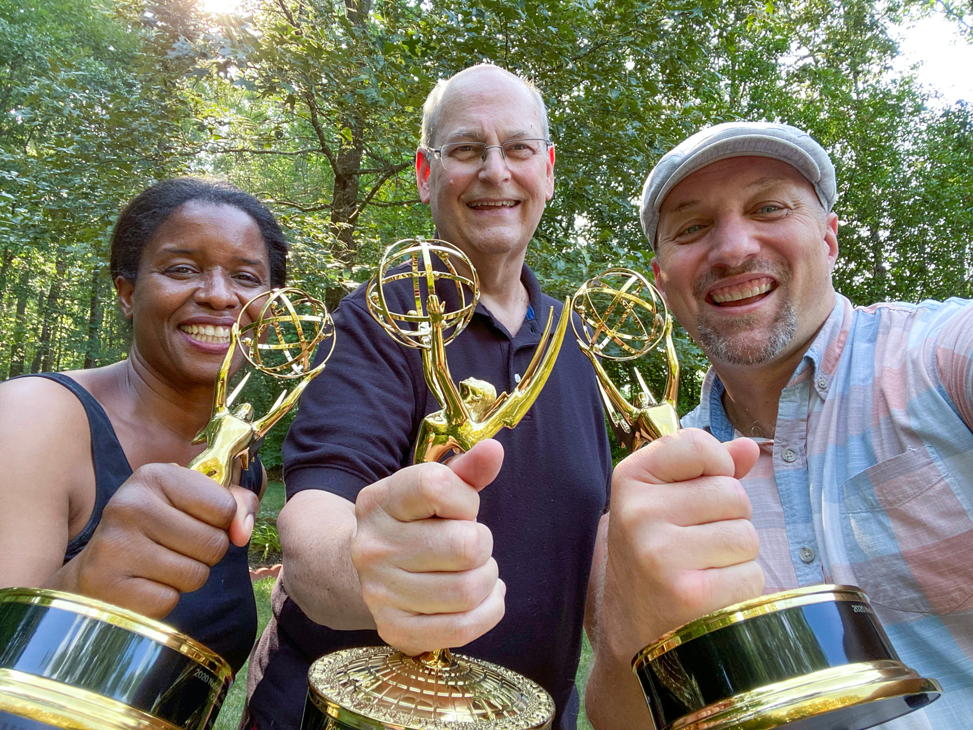 Emmy Award winners pose for a photo with their awards